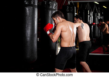 Male boxers training at a gym