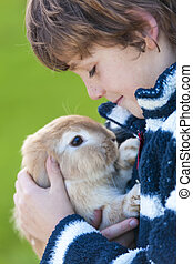 Male Boy Child Playing With Pet Rabbit