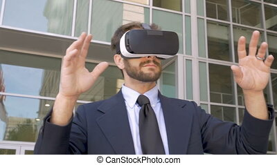 Male business executive enjoying a virtual reality experience with a VR headset
