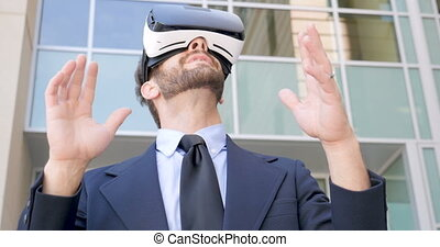 Male business executive enjoying virtual reality with VR...
