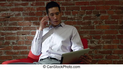 Male business professional working in a modern office