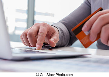 Male businessman doing online shopping with credit card