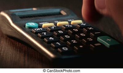 Male businessman hand pushing key on a calculator