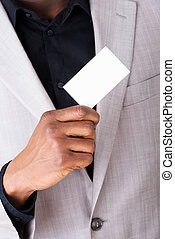 Male businessman holding a business card.