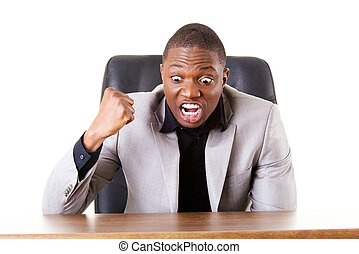 Male businessman sitting in a chair, angry.