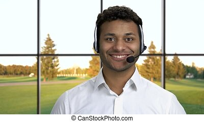 Male call center agent on windows background.