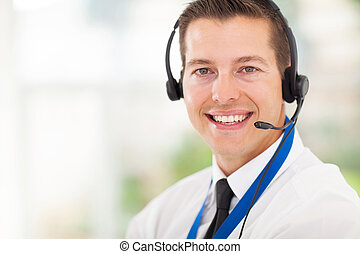 male call centre employee wearing a headset - successful...