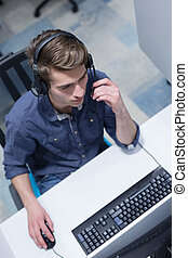 male call centre operator doing his job top view - top view...