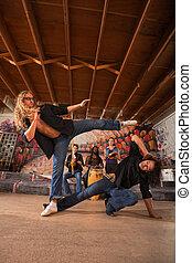 Male Capoeiristas Kicking