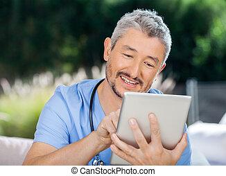 Male Caretaker Using Digital Computer