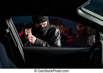 Male carjacker open car door with screwdriver - Male...