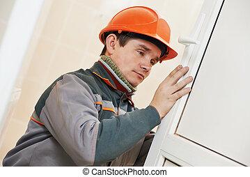 Male carpenter at lock installation