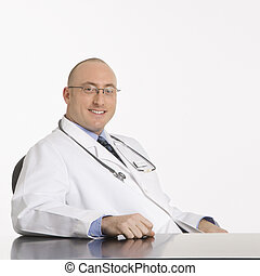 Male Caucasian doctor. - Caucasian mid adult male physician...