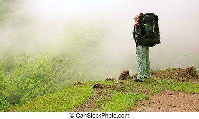 Male caucasian tourist trekking walking at himalayan mountains, Nepal