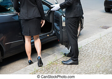 Male Chauffeur Opening The Car Door