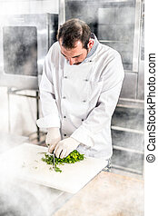Male chef chopped parsley
