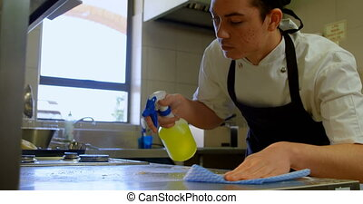 Male chef cleaning worktop in kitchen 4k - Male chef ...