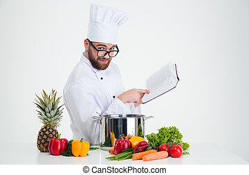 Male chef cook in glasses holding receipe book