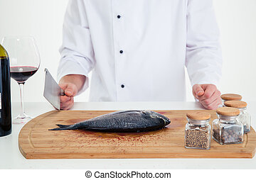 Male chef cook preparing fish