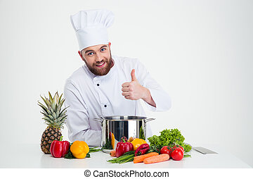 Male chef cook preparing food and showing thumb up