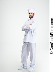 Male chef cook standing with crossed hands
