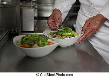 Male chef preparing meal