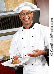 male chef present dessert - young happy male chef present...
