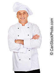 Male chef standing with folded arms