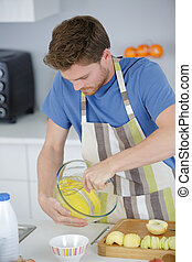 Male chef using whisk