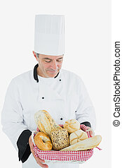 Male chef with bread basket