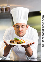 Male chef with eyes closed smelling - Closeup of a male chef...