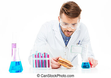 Male chemist making GMOs food