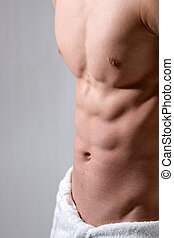 Male Chest - A young man\\\'s chest is sidelighted with his...