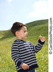 Male child holding a daisy