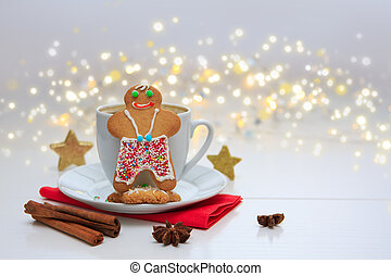 Male Christmas Cookie with garland and coffee cup.