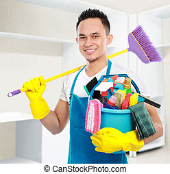 portrait of man with cleaning equipment cleaning the house