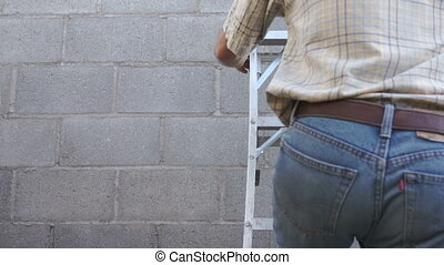 Male Climbing a Step Ladder