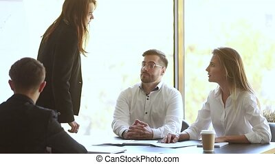 Male colleague set apart angry businesswomen argue fight at...