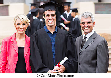 male college graduate and parents - cheerful male college...