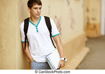 Male College Student - teenager on campus background, ...