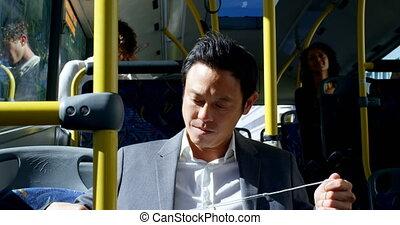 Male commuter travelling in bus 4k - Smart male commuter ...
