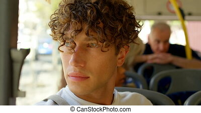 Male commuter travelling in bus 4k - Thoughtful male ...