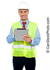 Male construction engineer using tablet pc