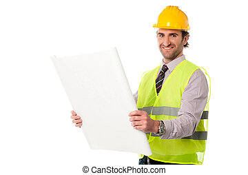 Male construction worker holding blueprint