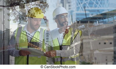 Male construction workers holding blueprints