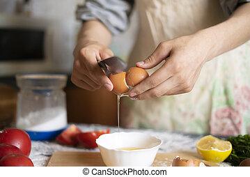 male cook baker hands break egg while food preparation f