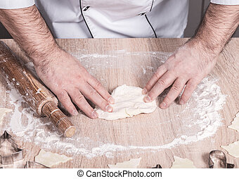 male cook preparing Christmas cookies