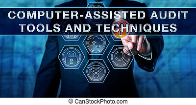 Male corporate manager pressing COMPUTER-ASSISTED AUDIT TOOLS AND TECHNIQUES on an interactive touch screen interface. Business risk metaphor and information technology concept for CAATTs.