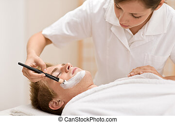 Male cosmetics - facial mask in salon - Male cosmetics -...