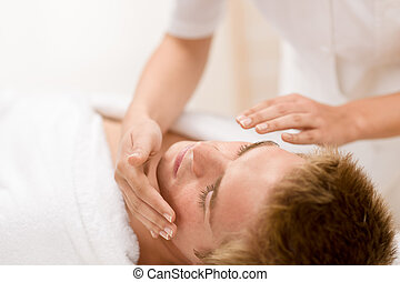 Male cosmetics - facial massage  in salon